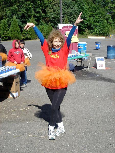 Trying to be graceful in an orange tutu!